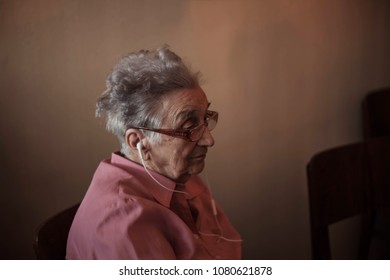 Portrait of senior woman listening to the music.