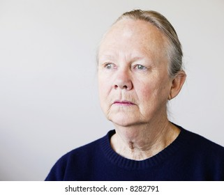 Portrait of a senior woman looking towards a light source.