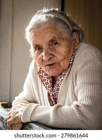 Portrait of senior woman on the porch