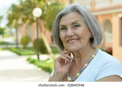 Portrait of a senior woman on a walk in tropic resort