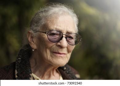 Portrait of senior woman outdoors. Closeup.