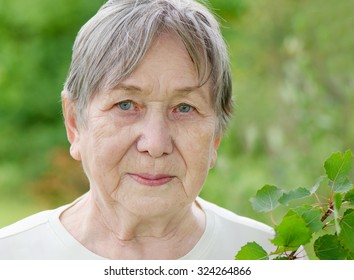 Portrait of senior woman outdoors in summer