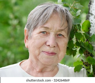 Portrait of senior woman outdoors in a summer