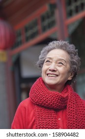 Portrait of senior woman outside traditional Chinese building