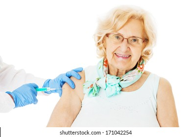 Portrait of senior woman receiving injection from doctor isolated over white background