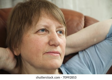 Portrait of a senior woman relaxed in an armchair at home