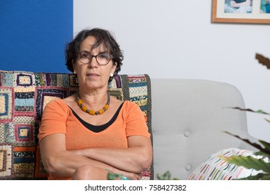 Portrait of a senior woman sitting on her sofa