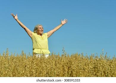 Portrait of a senior woman in summer field