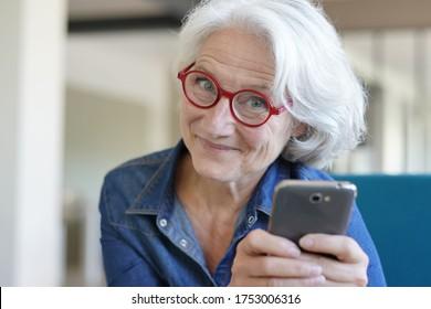 Portrait of senior woman using smartphone