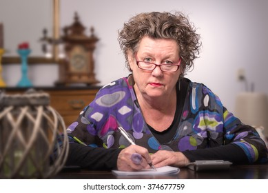 Portrait of a senior woman at work at home. Older woman. Elderly woman.