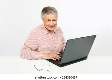 Portrait of a senior woman working on her laptop.