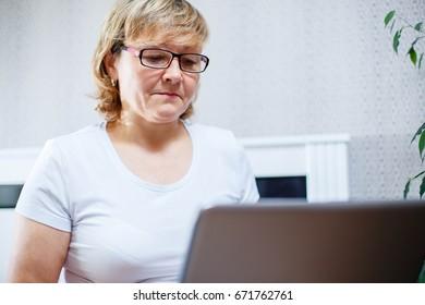 Portrait of a senior woman working on laptop