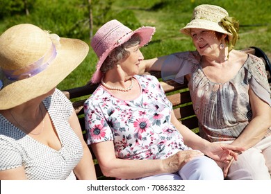 Portrait of senior women sitting on the bench in open air