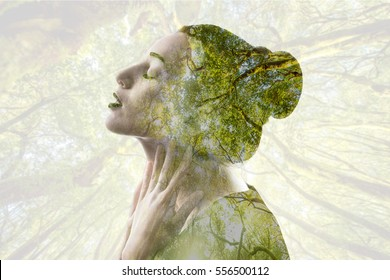 Portrait of sensitive woman with double exposure image effect combinated with green forest