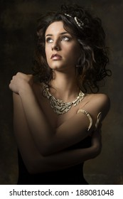 portrait of sensual brunette woman with curly hair-style, creative accessories looking up