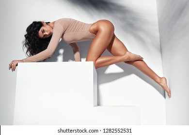 Portrait of a sensual latina woman with long, tanned legs