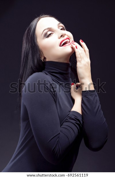 Portrait of Sensual Mid-Aged Caucasian Brunette Woman.Posing With Shaped Body Against Black. Vertical Image Composition