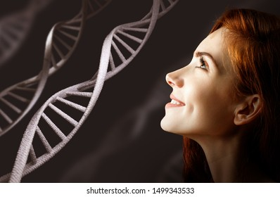 Portrait of sensual redhead woman among white DNA chains. Over dark background