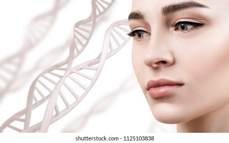 Portrait of sensual woman among DNA chains. Over white background.
