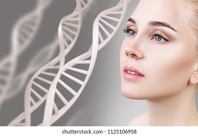 Portrait of sensual woman among DNA chains. Over gray background.