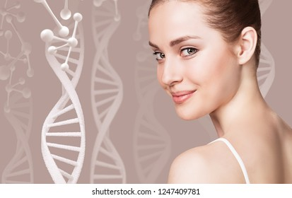 Portrait of sensual woman among DNA chains. Over beige background.