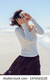 Portrait of a sensual woman in a dress near the sea