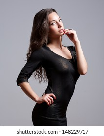 Portrait of sensual young festive brunette in sequin dress.