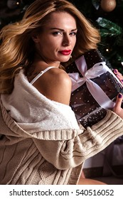 portrait of sensual young woman in a lingerie over christmas background