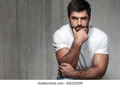 Portrait of serious adult man in a white T-shirt