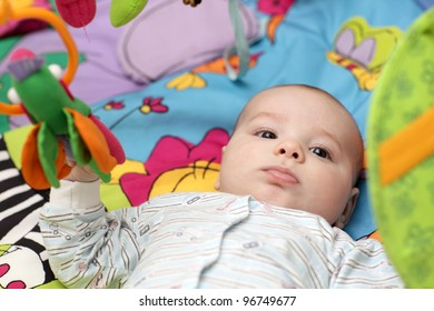 Portrait of serious baby boy at home