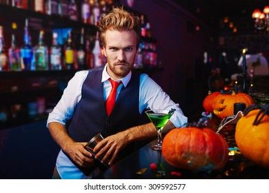 Portrait of a serious bartender working at Halloween night