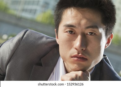 Portrait of serious businessman outdoors