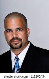 Portrait of serious businessman in a suit