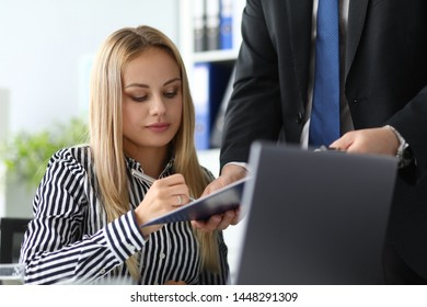 Portrait of serious businesswoman working in office. Man holding paper folder with contract and partner underwriting agreement. Biz concept. Blurred background