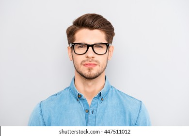 Portrait of serious calm minded businessman wearing glasses