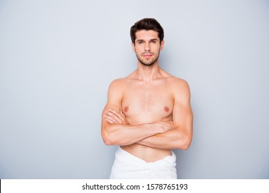 Portrait of serious charming guy have spa skincare treatment get flawless pure perfect skin wash body use white towel cross hands isolated over grey color background
