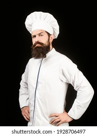 Portrait of a serious chef cook. Bearded chef, cooks or baker. Bearded male chefs isolated on black. Cook hat. Confident bearded male chef in white uniform. Serious cook in white uniform, chef hat.