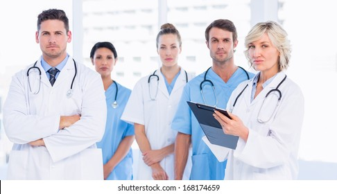 Portrait of serious confident group of doctors standing at the medical office