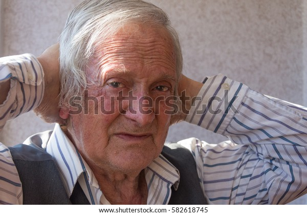 Portrait of serious elderly man of eighty years.Portrait of elderly man looking at camera.