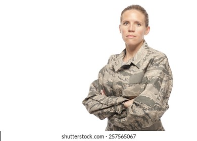Portrait of serious female airman against white background