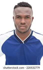 Portrait of a serious football player over white background