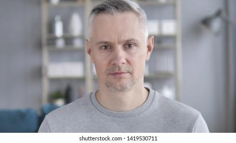 Portrait of Serious Gray Hair Man Looking at Camera