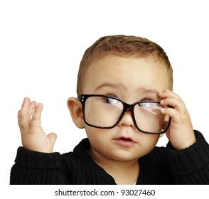 portrait of serious kid wearing glasses and doing a gesture over white