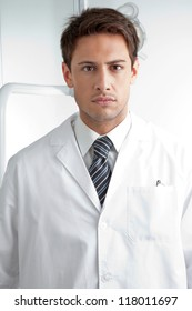 Portrait of serious male dentist wearing labcoat in clinic