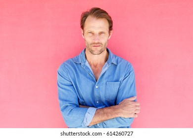 Portrait of serious male fashion model with blue shirt