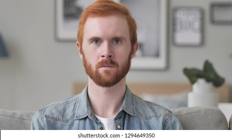 Portrait of Serious Man Looking at Camera