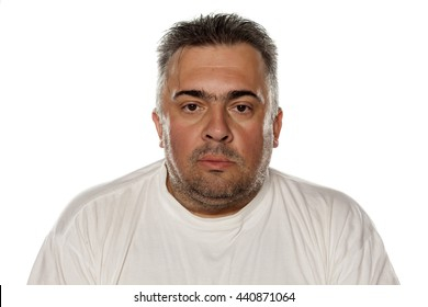 Portrait of a serious obese man