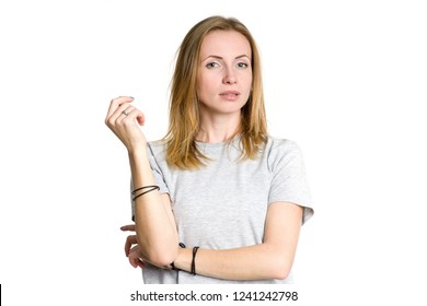 Portrait of a serious sad woman isolated on white background.