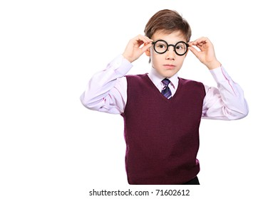 Portrait of a serious schoolboy in a  glasses. Isolated over white background.
