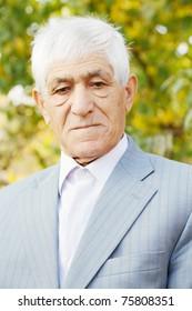 Portrait of serious senior man in formal wear